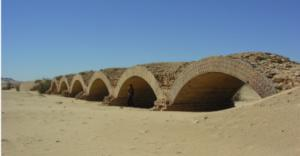 The arched railway bridge on the Wadi Halfa to Kerma railway a litte to the north-east of Delgo. Photo from Sudan Studies No. 53 p. 63. Credit: Derek Welsby.